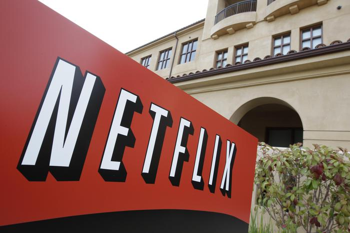 "FILE - This March 20, 2012 file photo shows Netfilx headquarters in Los Gatos, Calif. Netflix on Thursday, Oct. 8, 2015 announced it is raising the price of its Internet video service by $1 in the U.S. and several other countries to help cover its escalating costs for shows such as ""House of Cards"" and other original programming. (ANSA/AP Photo/Paul Sakuma, File)"